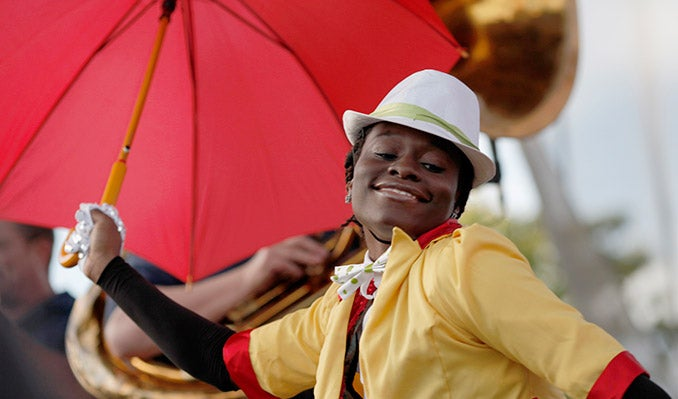 Parade-person-with-umbrella-678x399.jpg